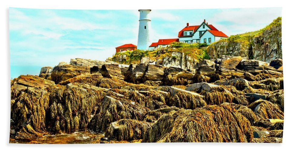 Portland Lighthouse Hand Towel featuring the photograph Light Over The Rocks by Adam Jewell