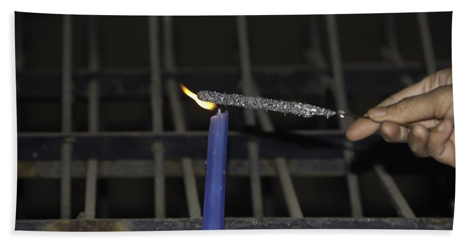 Action Hand Towel featuring the photograph Lighting A Sparkler With A Candle As A Part Of Diwali Celebrations by Ashish Agarwal