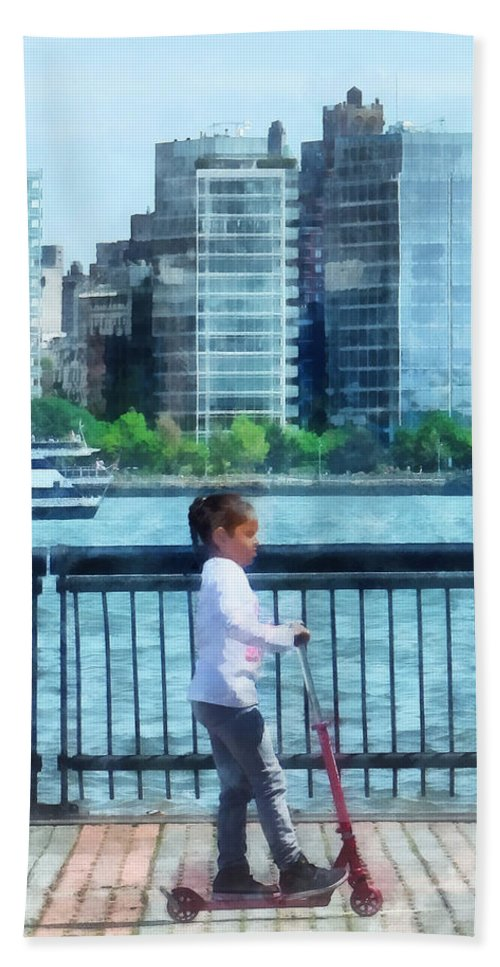 Girl Bath Sheet featuring the photograph Little Girl On Scooter By Manhattan Skyline by Susan Savad