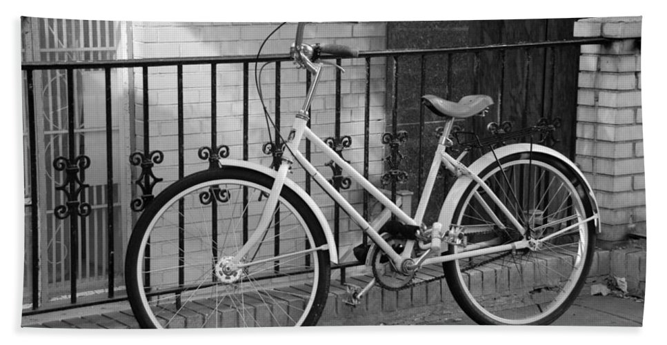 Black And White Hand Towel featuring the photograph Lonely Bike In Black And White by Rob Hans