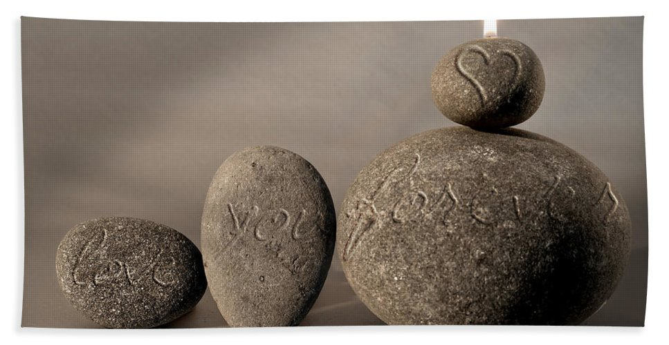Photo Bath Sheet featuring the photograph love you forever - An engraved message gives light to a stone heart by Pedro Cardona Llambias