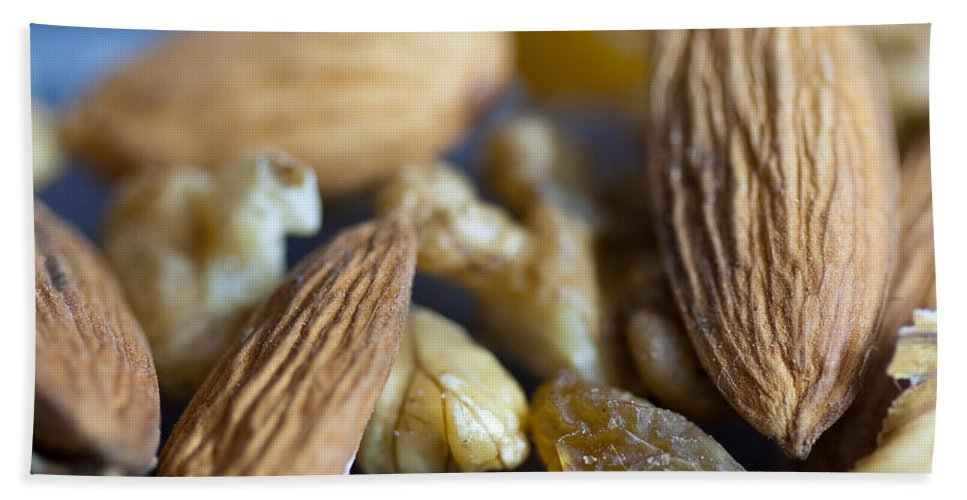 Macro Hand Towel featuring the photograph Macro Shots Of Various Dry Fruit Items Such As Almonds And Walnuts And Raisins by Ashish Agarwal