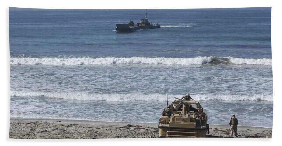 Improved Navy Lighterage System Bath Sheet featuring the photograph Marines Await The Arrival Of An by Stocktrek Images