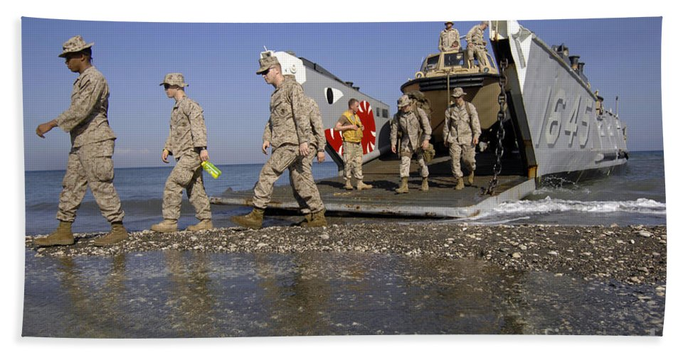 Operation Unified Response Bath Sheet featuring the photograph Marines Disembark From A Landing Craft by Stocktrek Images
