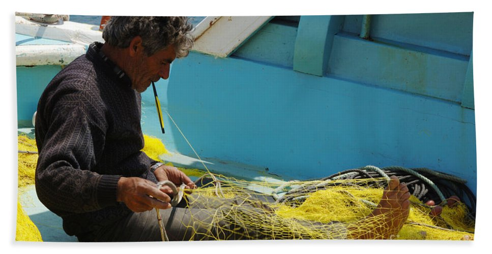 Fisherman Hand Towel featuring the photograph Mending His Nets by Bob Christopher