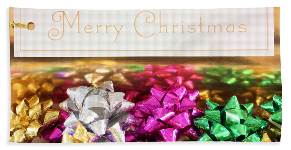 Bow Hand Towel featuring the photograph Merry Christmas Message With Colourful Bows by Simon Bratt Photography LRPS