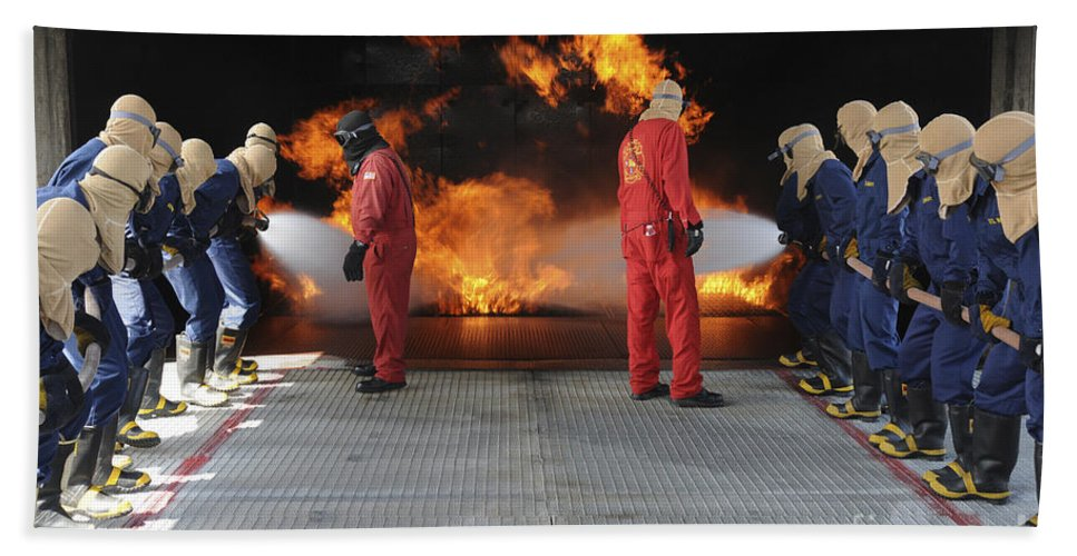 Midshipmen Hand Towel featuring the photograph Midshipmen Work Together To Battle by Stocktrek Images
