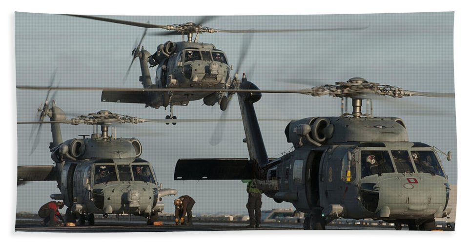 Warship Hand Towel featuring the photograph Military Helicopters Land On The Flight by Stocktrek Images