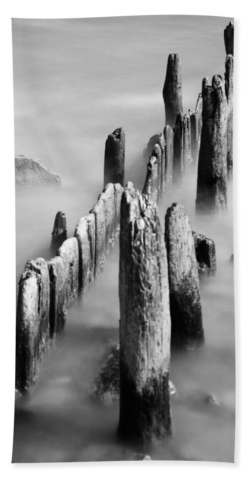 Misty Water Bath Towel featuring the photograph Misty Wooden Posts by Jonah Anderson