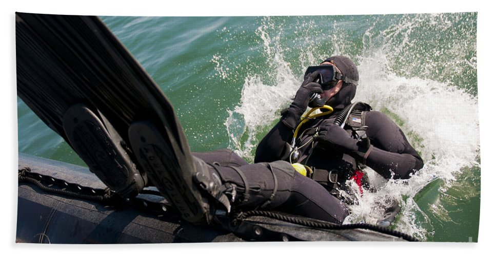 Operation Clean Sweep Hand Towel featuring the photograph Navy Diver Dives Into San Diego Bay by Stocktrek Images