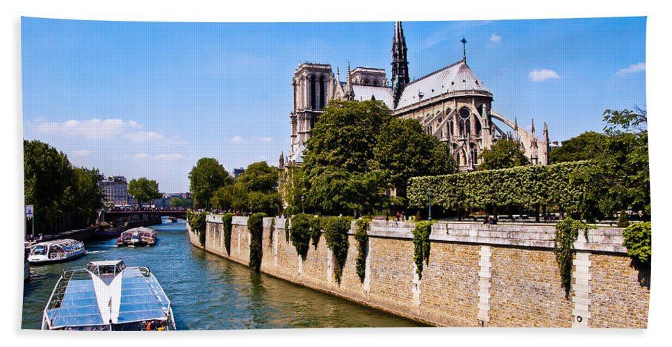 France Bath Sheet featuring the photograph Notre Dame Cathedral Along The Seine River by Jon Berghoff