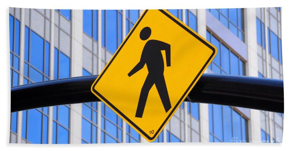 Pedestrian Bath Sheet featuring the photograph Pedestrian Crosswalk Sign In Business District by Gary Whitton