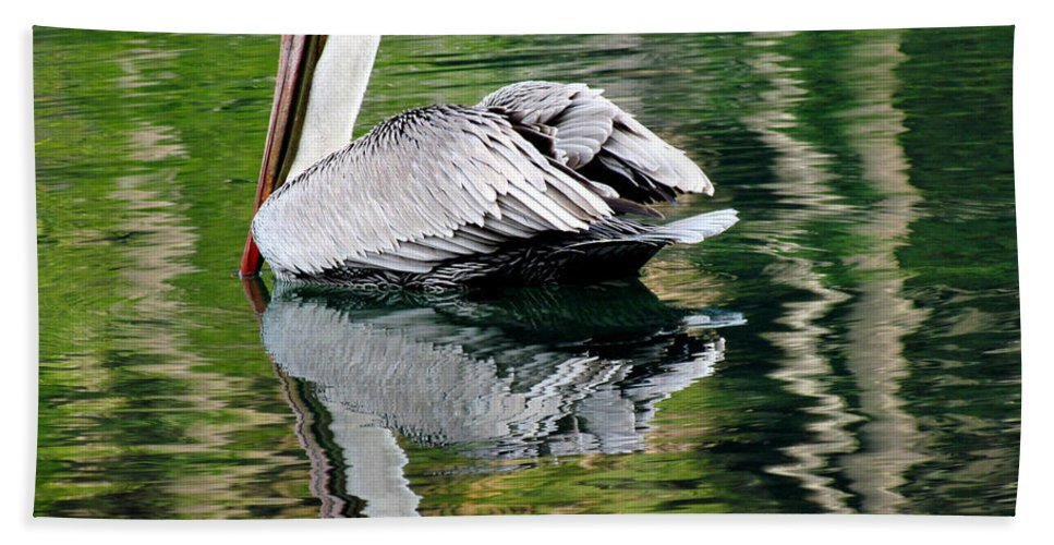 Nature Hand Towel featuring the photograph Pelican Reflecting by Judy Wanamaker