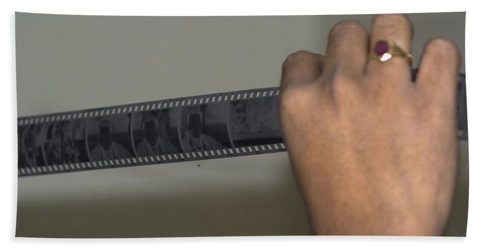 Expert Bath Sheet featuring the photograph Person Holding A Strip Of Photo Negatives by Ashish Agarwal