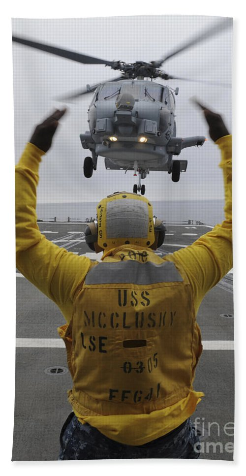 Guided Missile Frigate Hand Towel featuring the photograph Petty Officer Guides An Sh-60r Sea Hawk by Stocktrek Images