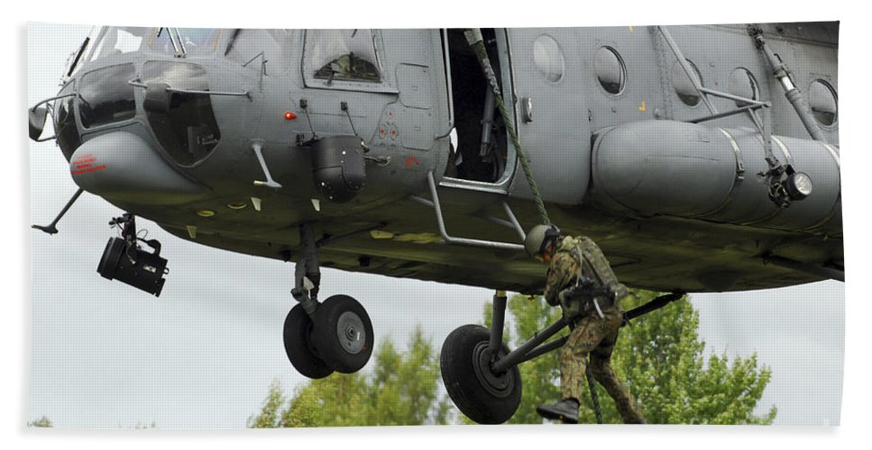 Mil Mi-8 Bath Sheet featuring the photograph Polish Special Forces Member Fast-ropes by Stocktrek Images