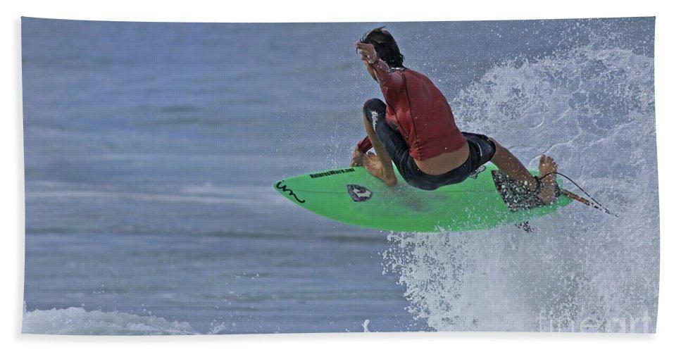 Surfer Bath Towel featuring the photograph Ponce Surfer Soar by Deborah Benoit