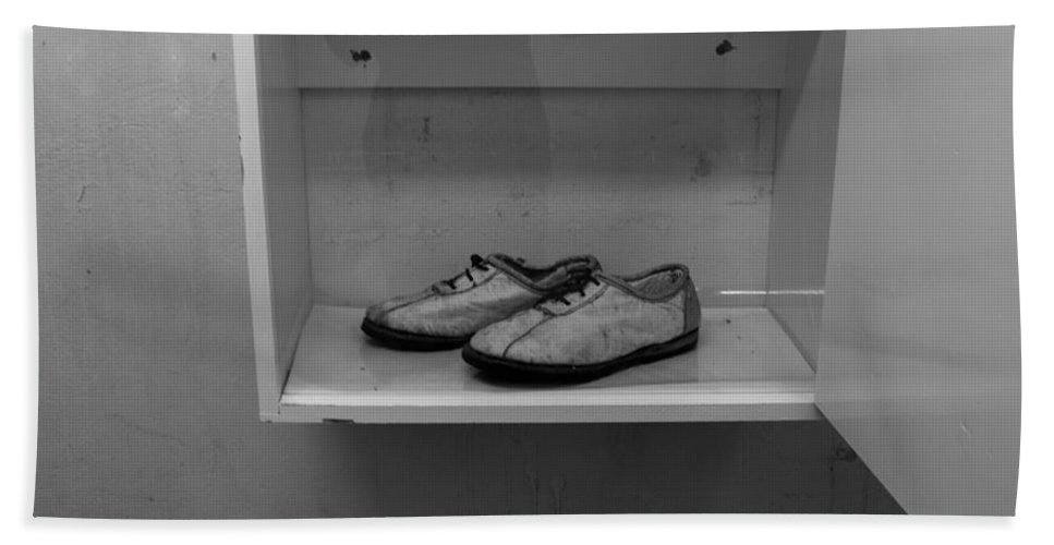 Robben Island Hand Towel featuring the photograph Prisoners Shoes by Aidan Moran