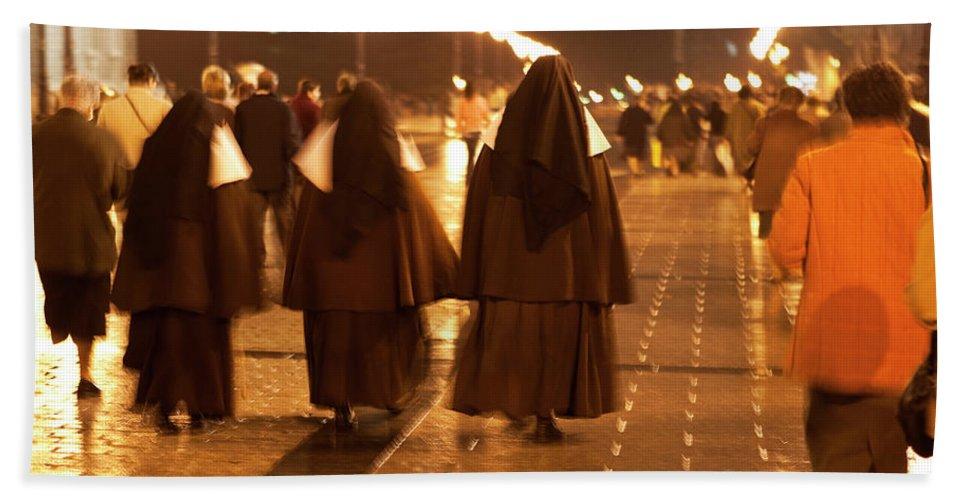 Madrid Bath Sheet featuring the photograph Rainy Night Nuns by Lorraine Devon Wilke