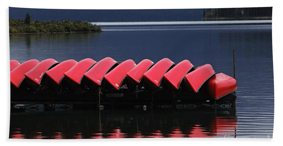 Red Canoes Hand Towel featuring the photograph Red Canoes Maligne Lake by Bob Christopher