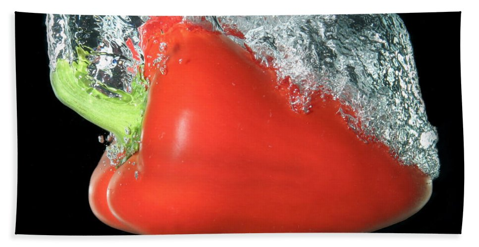 Pepper Hand Towel featuring the photograph Red Pepper Falling Into Water by Ted Kinsman
