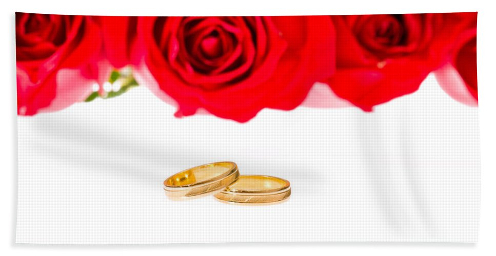 Backgrounds Bath Sheet featuring the photograph Red Roses And Wedding Rings Over White by U Schade