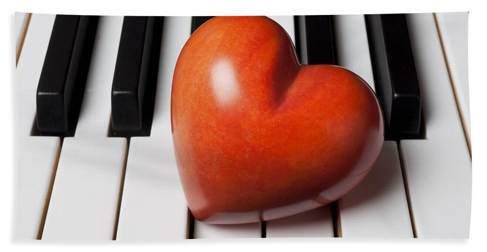 Red Bath Sheet featuring the photograph Red Stone Heart On Piano Keys by Garry Gay