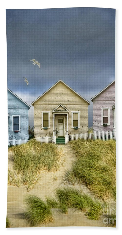 Pastel Hand Towel featuring the photograph Row Of Pastel Colored Beach Cottages by Jill Battaglia