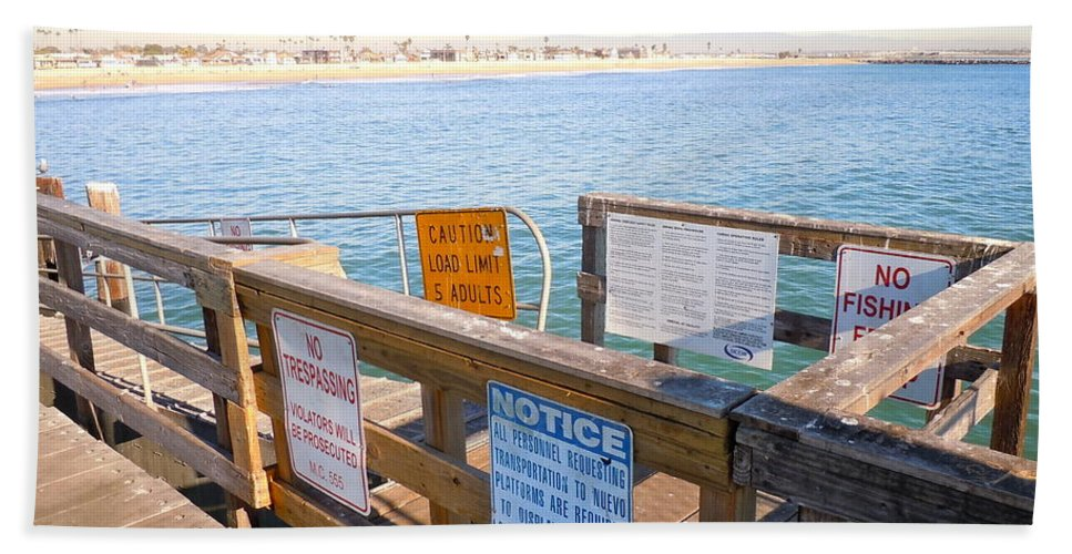 Beach Hand Towel featuring the photograph Rules Of The Pier by Customikes Fun Photography and Film Aka K Mikael Wallin