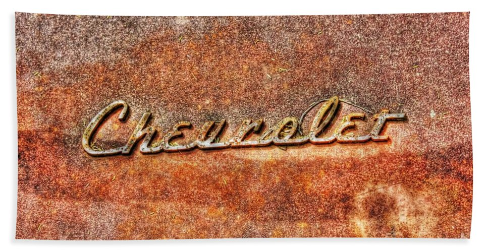 Old Hand Towel featuring the photograph Rusted Antique Chevrolet Logo by Dan Stone