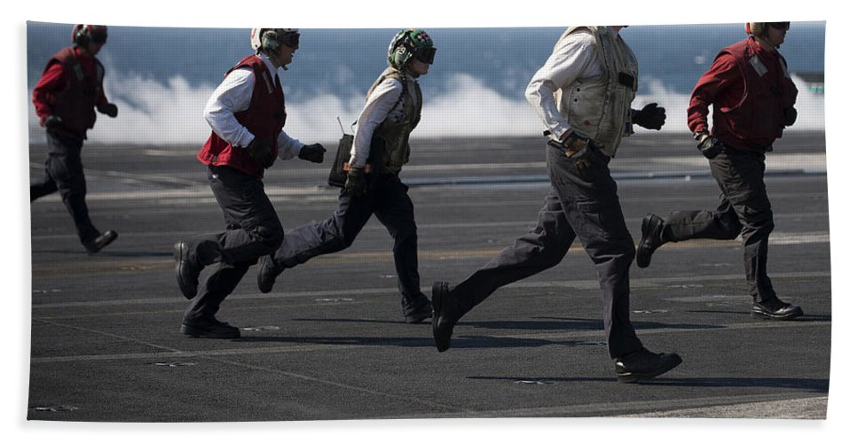 Warship Hand Towel featuring the photograph Sailors Clear The Landing Area by Stocktrek Images