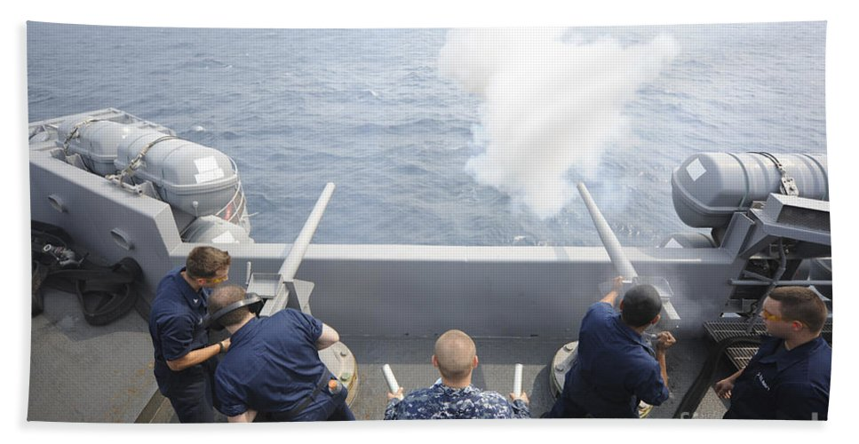 Weapon Hand Towel featuring the photograph Sailors Perform A 21-gun Salute Aboard by Stocktrek Images