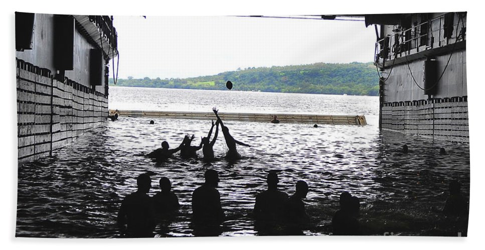 Football Hand Towel featuring the photograph Sailors Play Football During A Swim by Stocktrek Images