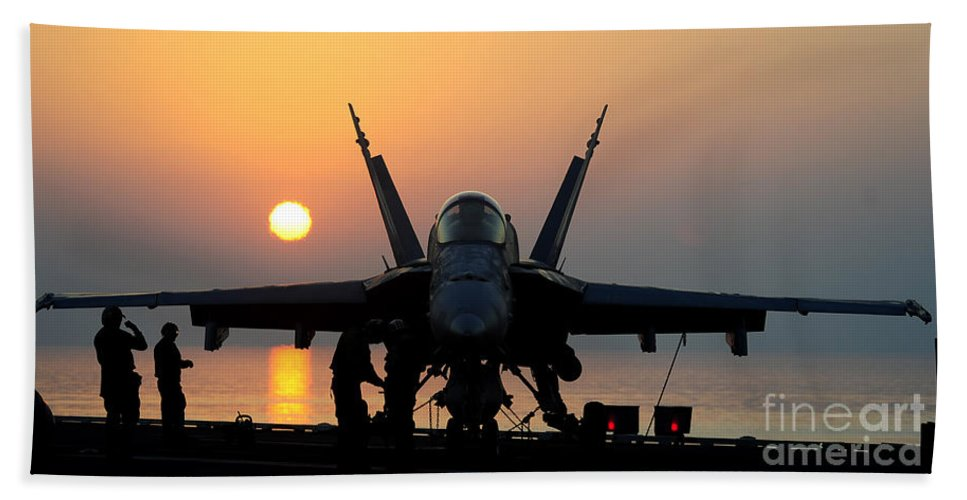 Flight Operations Hand Towel featuring the photograph Sailors Prepare An Fa-18c Hornet by Stocktrek Images