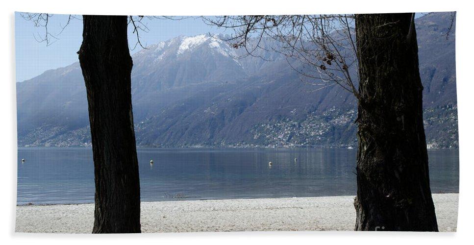 Beach Bath Sheet featuring the photograph Sand Beach On An Alpine Lake by Mats Silvan