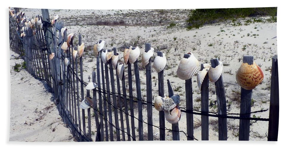 Shell Hand Towel featuring the photograph Shell-decorated Fence by Carla Parris