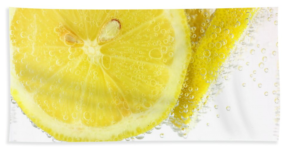 Lemon Hand Towel featuring the photograph Sliced Lemon In Fizzy Water by Simon Bratt Photography LRPS
