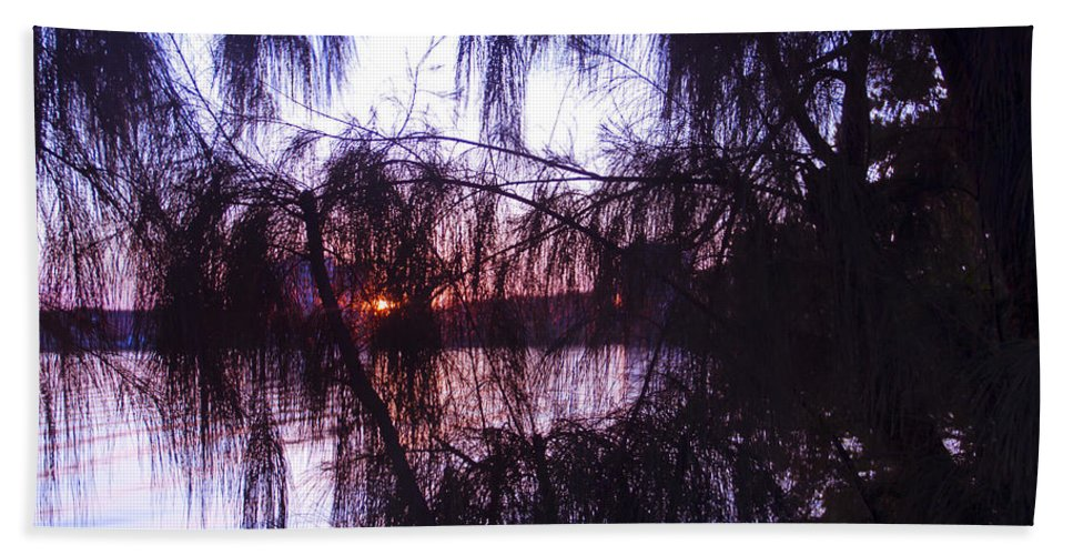 Sunset Hand Towel featuring the photograph Sneaking Behind The Trees by Roger Wedegis