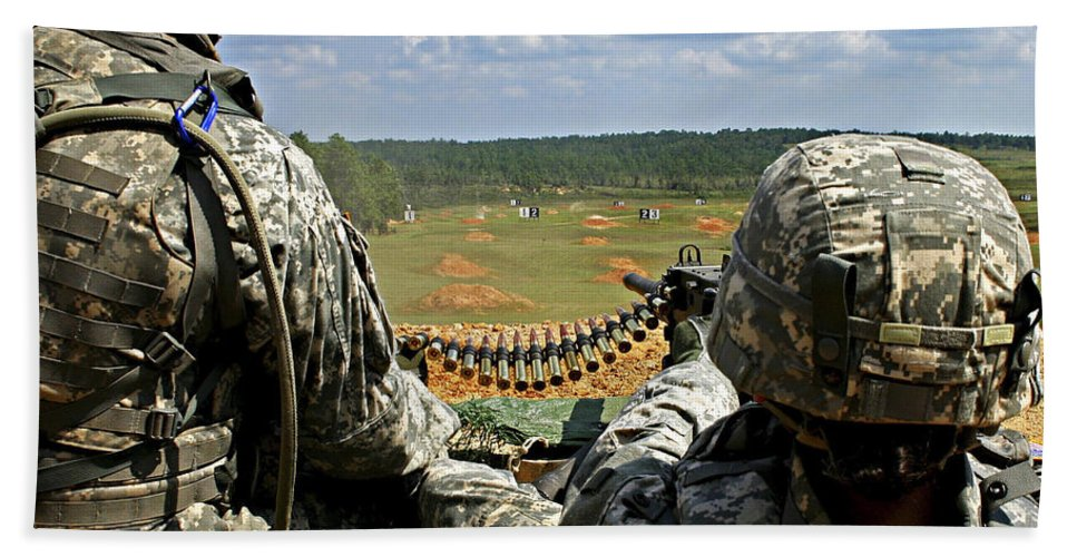 Camp Shelby Hand Towel featuring the photograph Soldier Feeds Ammunition To His Gunner by Stocktrek Images