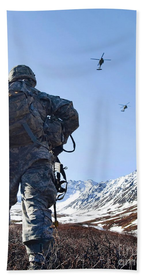 Army Hand Towel featuring the photograph Soldier Patrols Through Alaska's by Stocktrek Images