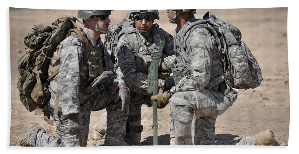 Iraq Hand Towel featuring the photograph Soldiers Discuss A Strategic Plane by Stocktrek Images