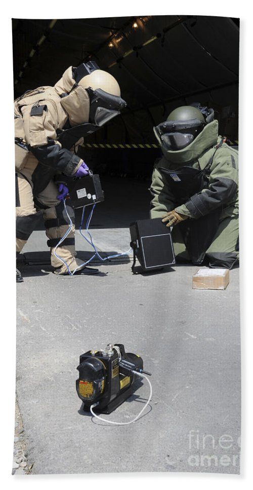 Kyrgyzstan Armed Forces Hand Towel featuring the photograph Soldiers Dressed In Bomb Suits Examine by Stocktrek Images