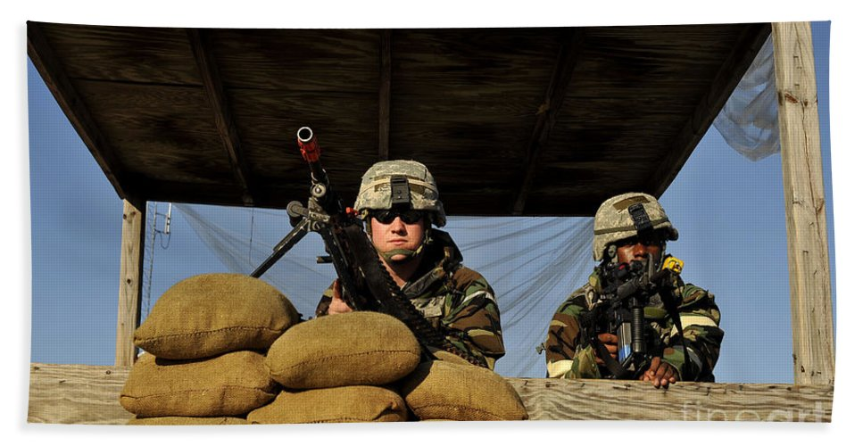 Assault Weapons Hand Towel featuring the photograph Soldiers Provide Security by Stocktrek Images