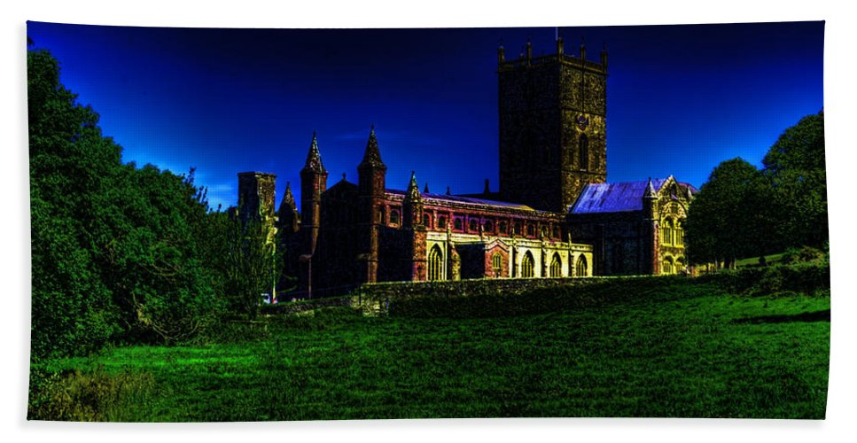 St Davids Cathedral Bath Sheet featuring the photograph St Davids Cathedral Pembrokeshire Glow by Steve Purnell
