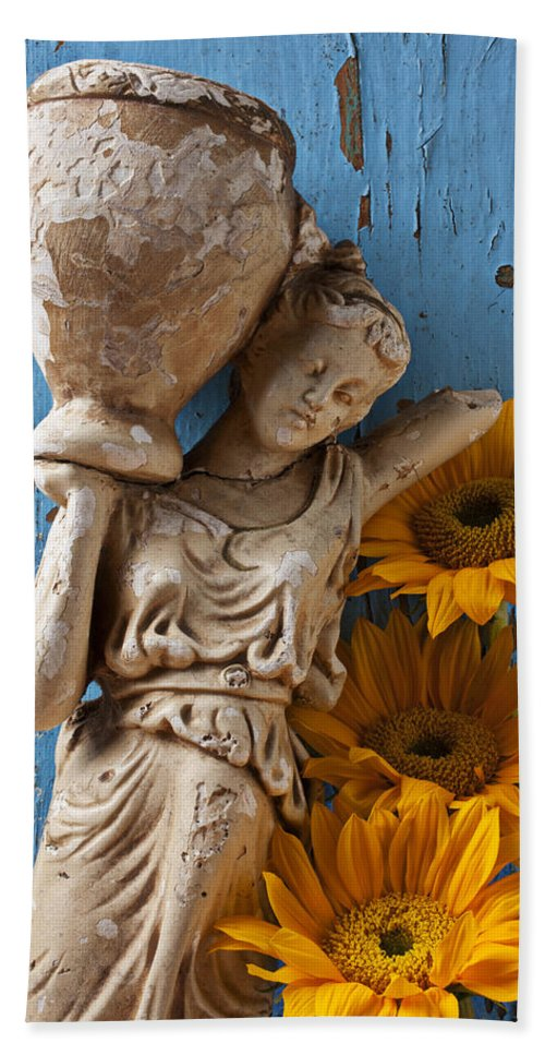 Statue Bath Sheet featuring the photograph Statue Of Woman With Sunflowers by Garry Gay