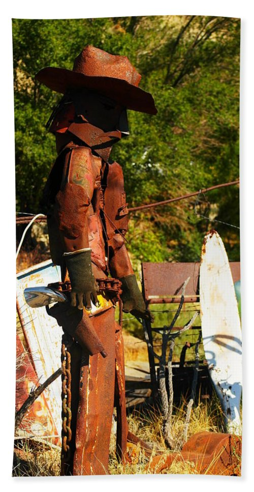 Steel Art Hand Towel featuring the photograph Steel Gunfighter by Jeff Swan