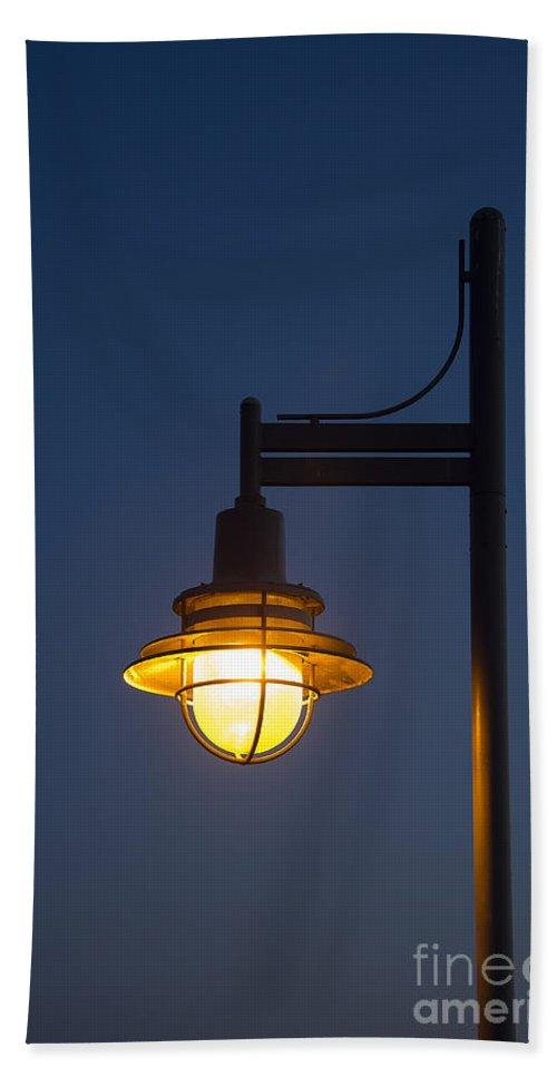 Amber Bath Sheet featuring the photograph Street Lamp At Night. by John Greim