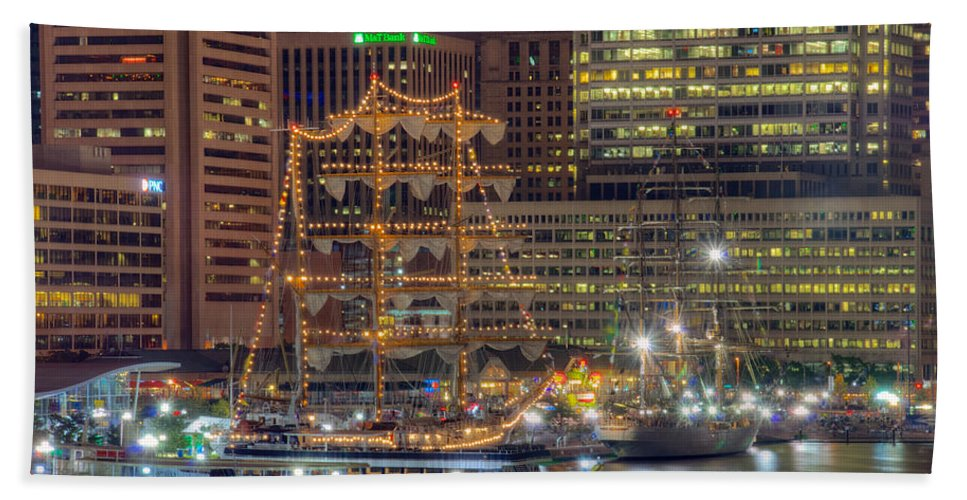 Baltimore Hand Towel featuring the photograph Tall Ships Docked At Inner Harbor by Mark Dodd