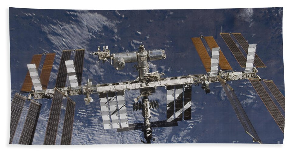 Terra Bath Sheet featuring the photograph The International Space Station by Stocktrek Images