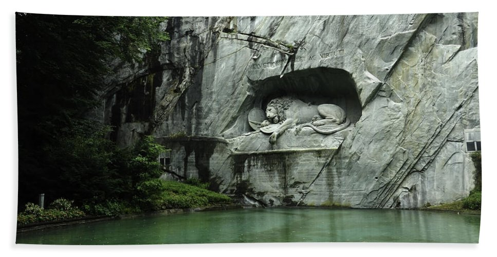 City Hand Towel featuring the photograph The Lion Monument In Lucerne Honouring The Swiss Soldiers Killed During French Revolution by Ashish Agarwal